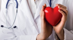 Bigstock-16675870-Female-doctor-with-stethoscope-holding-heart-isolated-on-white-background-460x250