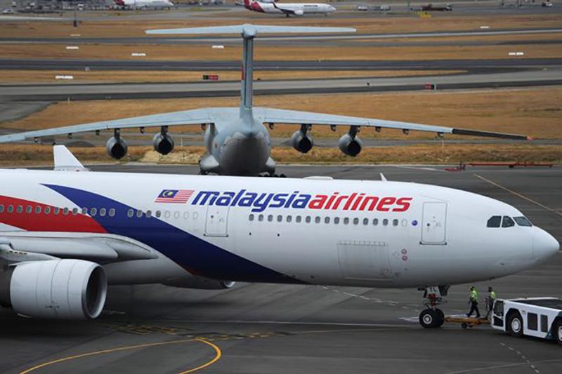 FILE Australian Transport Safety Bureau ATSB Announce Missing Malaysia Airlines Flight MH370 Not - مرد استرالیایی مدعی است قطعات هواپیمای پرواز MH370 را در گوگل ارث پس از ۴ سال جستوجو یافته است